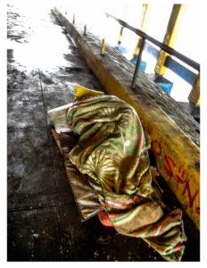 man-sleeping-under-bridge-640
